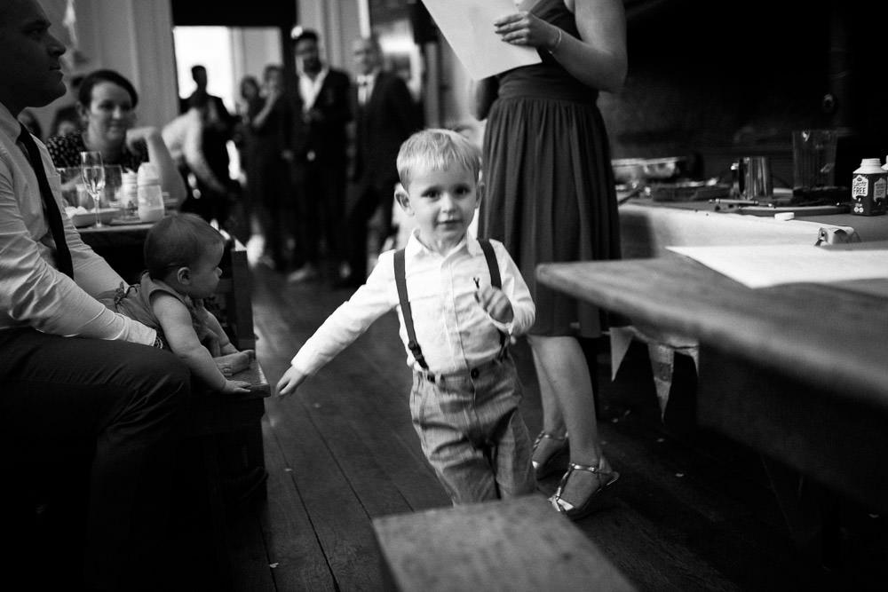 little boy running in room full of people