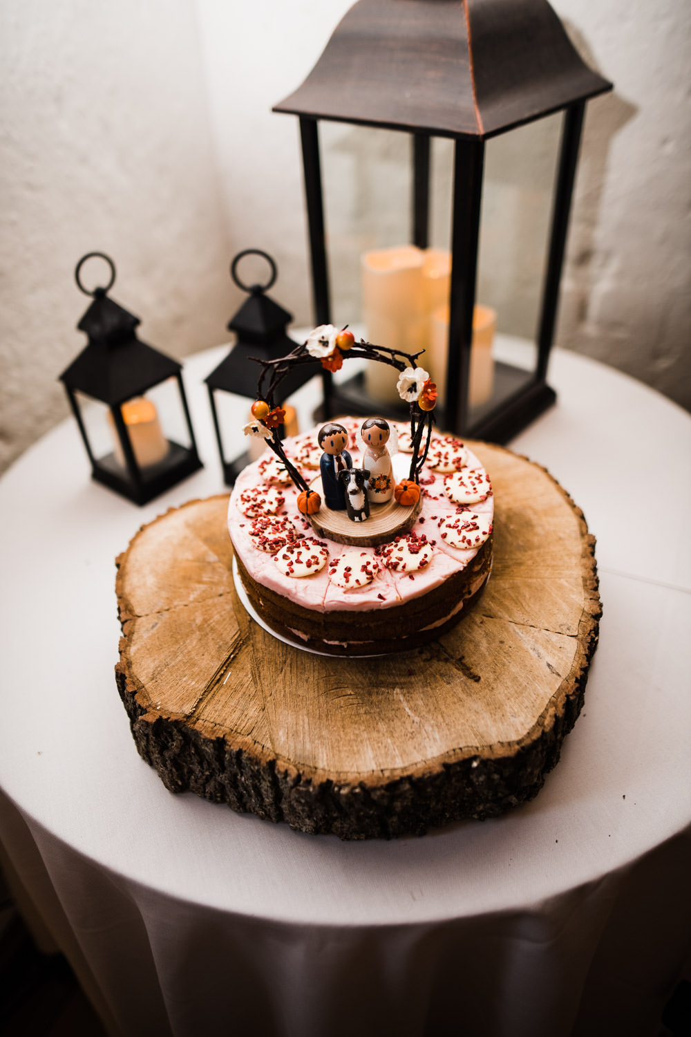 wedding cake on a log stand