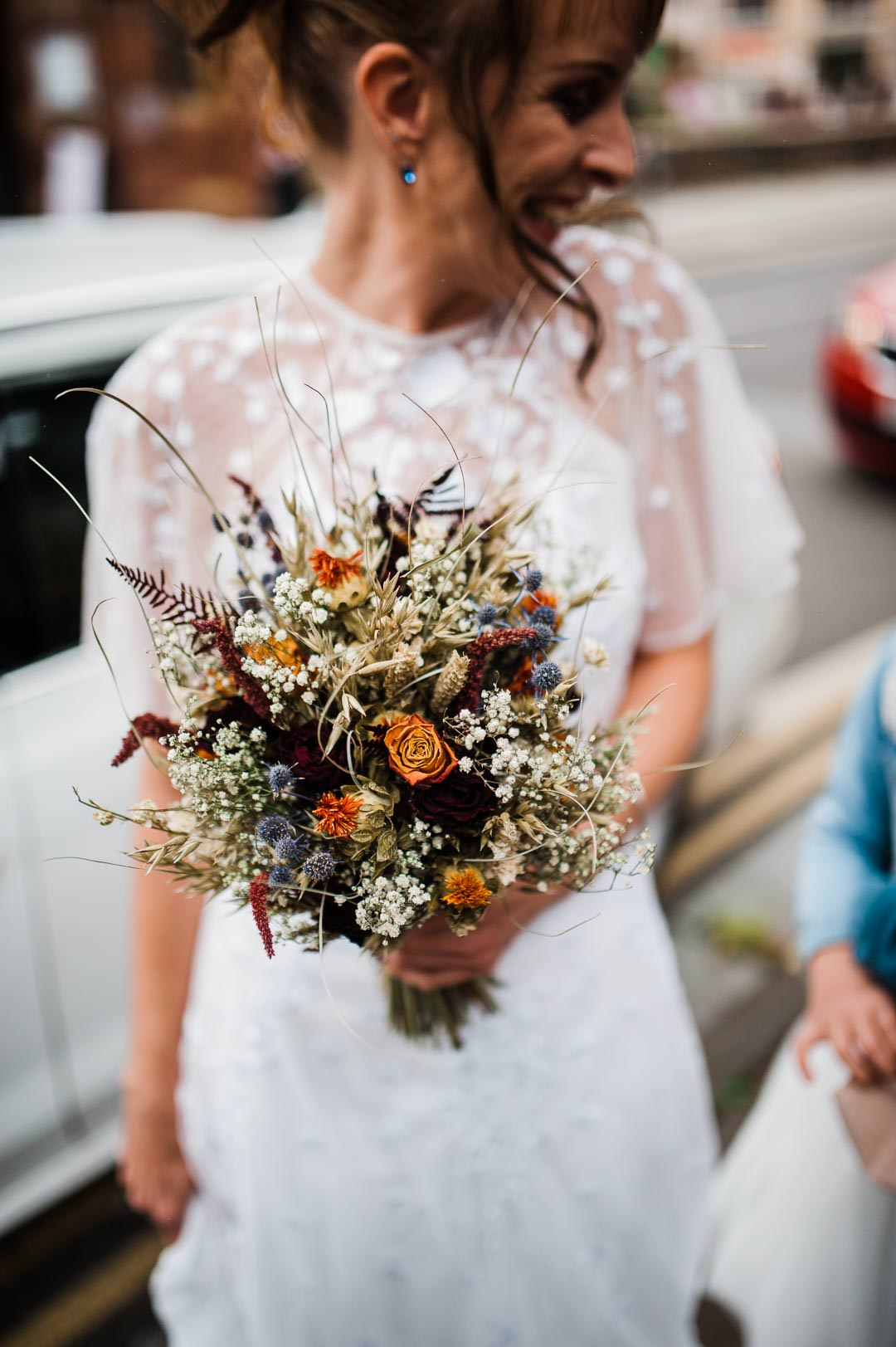 wedding bride holding orange flowers