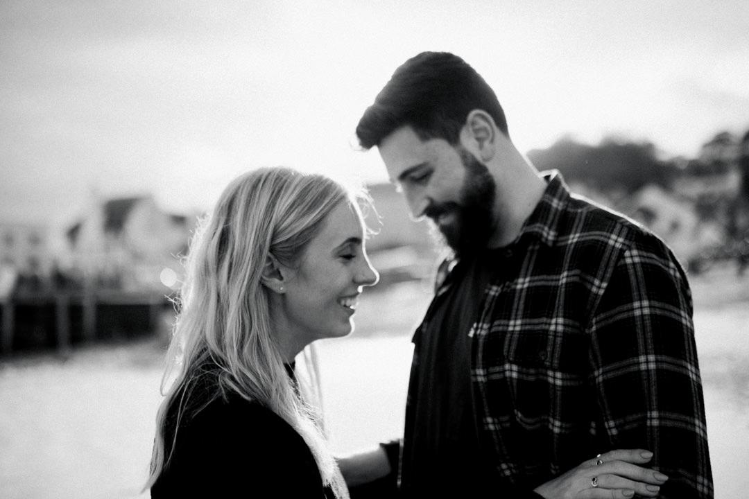 young couple wedding proposal on beach