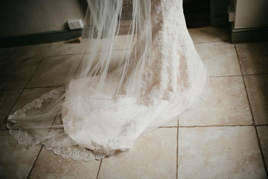 white wedding dress with flower details